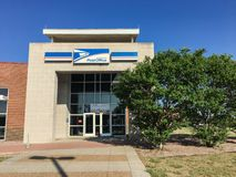Facade entrance of USPS store in Irving, Texas, USA. IRVING, TX, USA-SEP 2, 2018:Entrance exttorior of USPS store sunny summer clear blue sky. The United States royalty free stock photos