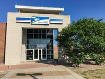 Facade entrance of USPS store in Irving, Texas, USA. IRVING, TX, USA-SEP 2, 2018:Entrance exttorior of USPS store sunny summer clear blue sky. The United States stock photos