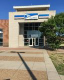 Facade entrance of USPS store in Irving, Texas, USA. IRVING, TX, USA-SEP 2, 2018:Entrance exttorior of USPS store sunny summer clear blue sky. The United States stock photo
