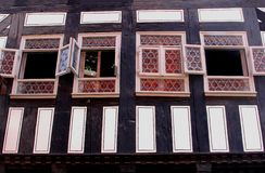 Structures of a fachwerk house with stained glass windows, Erfurt, Germany. Facade of a fachwerk house at the Merchants Bridge Kraemerbruecke in Erfurt in Stock Photography