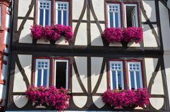 Facade of Fachwerkhaus with flowers in Germany Stock Photos