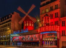 Facade of the famous Moulin Rouge cabaret in Paris, France, known as the birthplace of the can-can dance after sunset. Paris, France - January 20, 2015: Facade royalty free stock photo