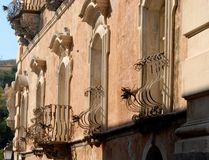 Facade, with five doors and a balcony, an elegant building in Ragusa in Sicily (Italy) Royalty Free Stock Photos