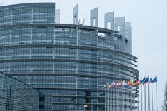 Facade with flags of european union parliament. Strasbourg - France - 24 December 2017 - facade with flags of european union parliament Stock Photos