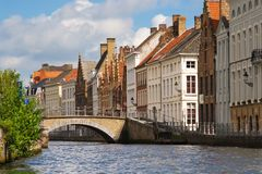 Facade of flemish houses and canal in Brugge Stock Photography