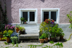 Facade with flowerpots Royalty Free Stock Photos