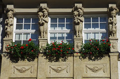 Facade with flowers on balconies. Royalty Free Stock Image