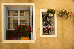 Facade flowers blue window Brantome France royalty free stock photography