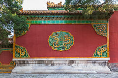 Facade in forbidden city with dragon Stock Photo