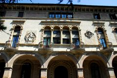 Facade with four-light and small balconies of a medieval palace in Padua in the Veneto (Italy). Photo made to the facade of an ancient medieval palace in Padua Royalty Free Stock Photo