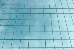 Facade fragment of a modern office building. Exterior of glass wall with abstract texture royalty free stock photos