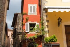 Facade fragment of typical Italian house, Tuscany, Italy. The view of typical Italian house facade fragment, Tuscany, Italy stock photography