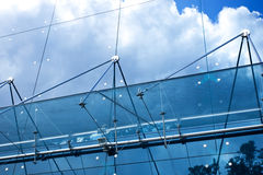 Facade of glass. Modern building in downtown with reflection of sky and clouds Royalty Free Stock Photo