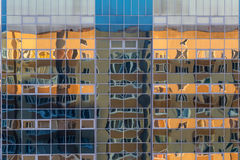 Facade of a glass wall of a modern building with  reflection of another building Stock Image
