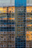 Facade of a glass wall of a modern building with  reflection of another building Stock Images