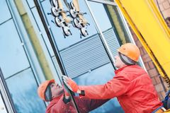 Facade glass window installation. Male industrial builder worker at facade glazing royalty free stock photo