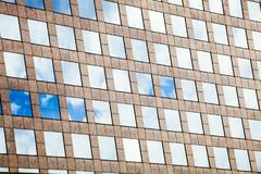 Facade glass windows with sky reflected. Modern office building. Facade glass windows with sky reflected and architecture of a modern office building Royalty Free Stock Image