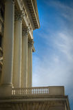 Facade with greek style columns. Large greek freestone columns on a building stock image