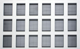 Facade with grey shutters Stock Image