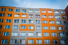 Facade of high modern apartment building under blue sky stock photo
