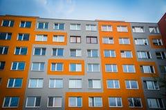 Facade of high modern apartment building under blue sky stock photo