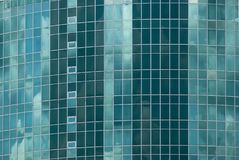 Facade a high-rise of glass with elliptical basic shape and pointed ends with hotel Stock Images