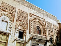 Facade of historical building in Zabid. External decoration of old building in Zabid historical city near Hodeidah Yemen Islamic pattern stock photography