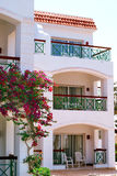 Facade of Hotel with balconies and windows decorated with flowers , Egypt Stock Photos