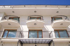 Facade of a hotel building with wrought iron balconies, Bulgaria Stock Photography