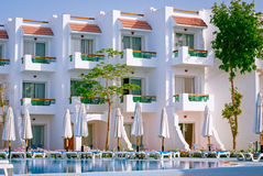 Facade Hotel with swimming pool and sun loungers, Egypt Stock Photos