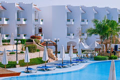 Facade Hotel with swimming pool and sun loungers, Egypt Stock Images