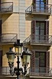 Facade of a house in Barcelona and a street lamp stock photography