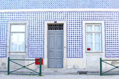 Facade house blue white mosaic tiles, Lisbon, Portugal Stock Photography