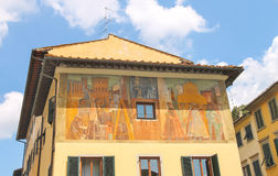 Facade of house decorated with a fresco. Florence, Italy Stock Photos