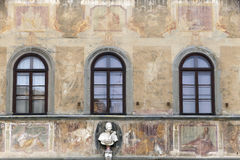 Facade of house is decorated with fresco in florence, toscany, i Royalty Free Stock Image