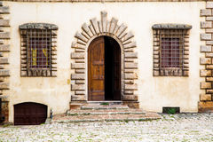Facade of the house in medival Tuscany town. Facade of the house - door and windows - in the medival Tuscany town Royalty Free Stock Photos