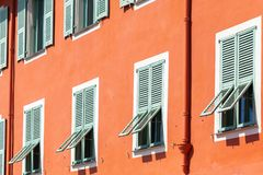 Facade of a house in the old town of Nice. Windows with shutters. French Riviera, Nice, France stock photography