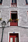Facade of the house with red tiles and a door and balconies. And a lantern royalty free stock images