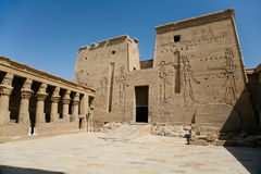 Facade of interior Temple of Isis in Philae. Stone carved colonnade and facade door of landmark interior Temple for the goddess Isis, Egyptian public monument stock photos