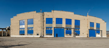 Facade of large industrial warehouse Stock Photo