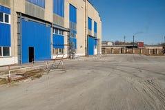 Facade of large industrial warehouse Stock Photos