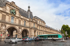 Facade of The Louvre museum with entrance gates, Paris Royalty Free Stock Photography