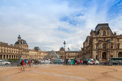 Facade of The Louvre Museum with tourists Stock Photography