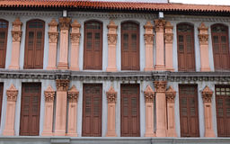 Facade of many old houses in Chinatown, Singapore Stock Photos