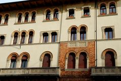 Facade with many windows and two elegant balconies of a historic palace in Treviso in the Veneto (Italy) Stock Photography