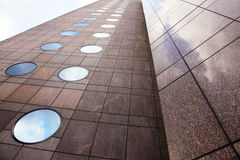 Facade of marble and round windows Royalty Free Stock Images