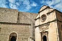Facade of a medieval church in the city of Dubrovnik Stock Images