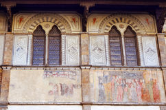 Facade of medieval palazzo, decorated with frescoes in Florence Stock Photography