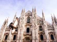 Facade of Milan Cathedral Duomo from the Square Piazza del Duomo, Lombardy, Italy. The largest church in Italy. Image with copy. Space royalty free stock photo