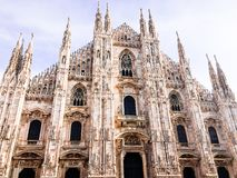Facade of Milan Cathedral Duomo from the Square Piazza del Duomo, Lombardy, Italy. The largest church in Italy. Image with copy. Space stock photos